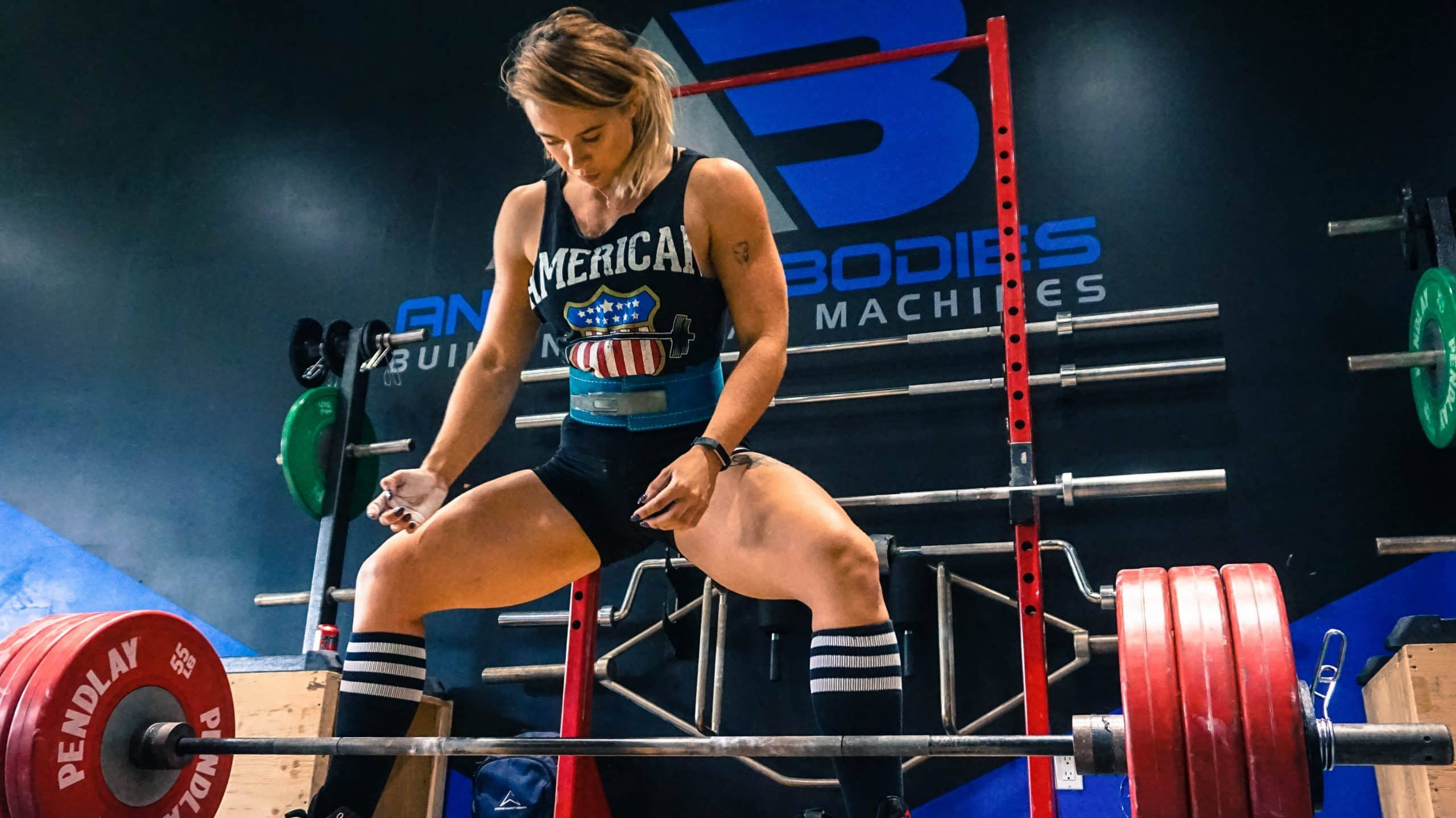 Woman about to lift with a lifting belt